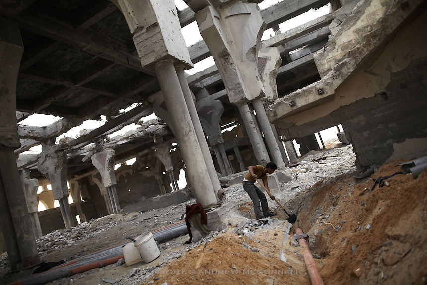 A boy digs out a pipe from the floor of the main terminal building at Yasser Arafat International Airport in southern Gaza. The airport was destroyed by Israeli warplanes in 2001 and 2002, and has become a source of building materials for much needed reconstruction in Gaza.
