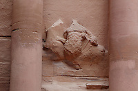 Relief carving of figure with horse from the facade of the Treasury of the Pharaohs or Khazneh Firaoun, Petra, Ma'an, Jordan. The Treasury, 100 BC - 200 AD, was originally built as a royal tomb and is so called after a belief that pirates hid their treasure in an urn held here. Carved into the rock face opposite the end of the Siq, the 40m high treasury has a Hellenistic facade with three bare inner rooms. Petra was the capital and royal city of the Nabateans, Arabic desert nomads. Picture by Manuel Cohen