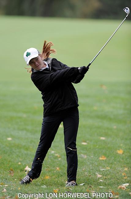 Ann Arbor High School's annual girl's golf city tourney at Barton Hills C.C., Tuesday, September 30, 2014.