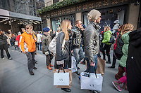 Shoppers on Fifth Avenue in New York looking for bargains on Black Friday, the day after Thanksgiving, Friday, November 29, 2013. Many retailers, including Macy's, opened their doors on Thanksgiving or opened up for Black Friday the night before extending the shopping day into over 24 hours. (© Richard B. Levine)
