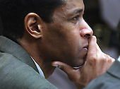Sniper suspect John Allen Muhammad listens to testimony during his trial at the Virginia Beach Circuit Court  in Virginia Beach, Virginia on October 24, 2003. <br /> Credit: Davis Turner - Pool via CNP