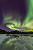The aurora reflect in the Koyukuk River in Alaska's Arctic.