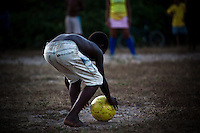 Countryside Brazil soccer. In Brazil black boys with remarkable talent for football usually have the nickname of Pelé. Rural area of Maranhao State, Northeast Brazil. Player is carefully positioning the ball for a penalty shoot-out.