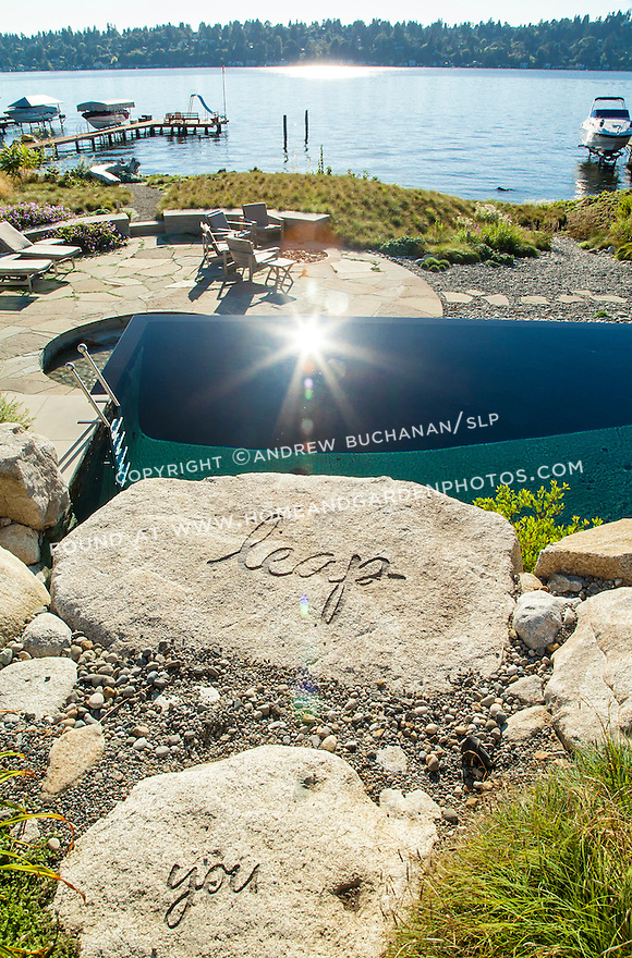"Stones leading up to the infinity pool with the whimsical message, ""look before you leap"""