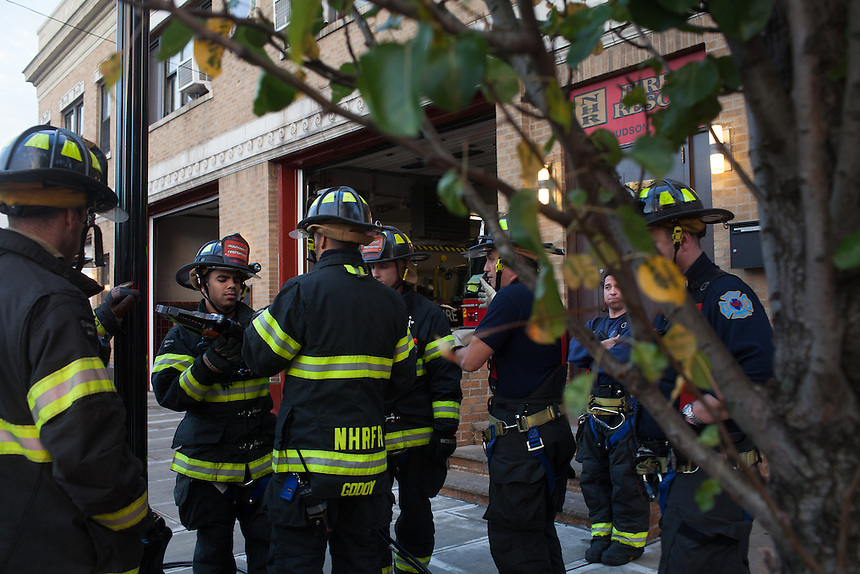 Probationary Fire fighters and veterans Victor Ramos, Andres Godoy and AJ Maresca  left and center, are trained by Captain Joe McLean, right, at the 16th Street Fire House of the North Hudson Regional Fire and Rescue in Union City, NJ on November 07, 2013. Many vets say after the military they're still looking for a career with a sense of public service. Some vets have found that at the North Hudson Regional Fire and Rescue in New Jersey.