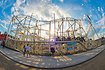 Brooklyn, New York, USA. 10th August 2013. Visitors watch riders on the Steeplechase ride at Luna Park at Coney Island amusement park. Taken with 180 degree fisheye lens.