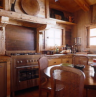 The chalet kitchen with cupboards made from wood reclaimed from a Beaufort cheesemaker