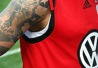 Body Art. Santino Quaranta of DC United at a practice session for DC United and AC Milan at RFK Stadium in Washington DC on may 25 2010.