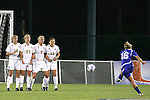 7 November 2007: Duke's Elisabeth Redmond (16) takes a shot against the defensive wall of Wake Forest's (l to r) Maggie Horne, Amy Smerdzinski, Camelyn Dillon, and Allie Sadow. Wake Forest University defeated Duke University 1-0 in overtime at the Disney Wide World of Sports complex in Orlando, FL in an Atlantic Coast Conference tournament quarterfinal match.