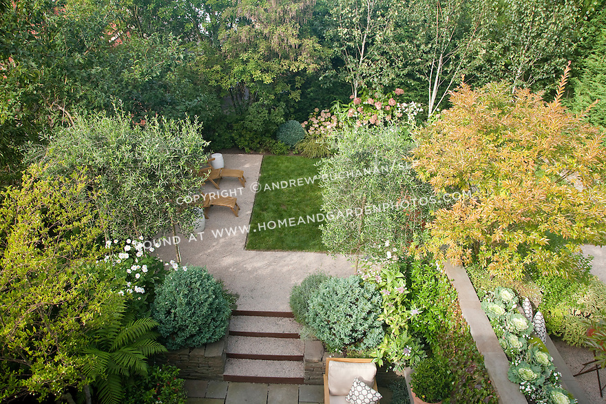 An overhead view of the lower fireplace area patio and the middle lawn area in this multi-level Seattle backyard.