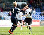 Ross County v St Johnstone&hellip;..30.04.16  Global Energy Stadium, Dingwall<br />Graham Cummins battles with Andrew Davies<br />Picture by Graeme Hart.<br />Copyright Perthshire Picture Agency<br />Tel: 01738 623350  Mobile: 07990 594431
