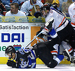 - Council Bluffs, IA. 4/29/2003 Lincoln Stars BEN GORDON gets tripped up during a scramble for the puck at the Mid America Center Tuesday evening (Chris MachianPrairie Pixel Group)