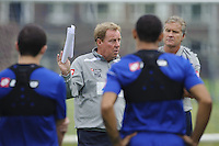 QPR manager Harry Redknapp holds team talks during training