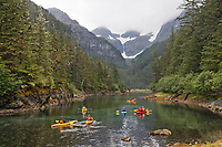 Kayaking in a sheltered cove on Knight Island, Prince William Sound, Chugach National Forest, southcentral, Alaska.