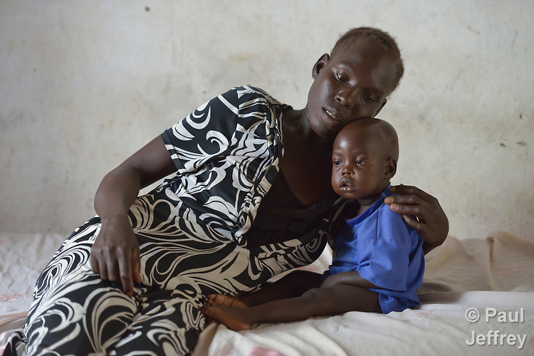Alat Yai comforts her child Aguil in a ward for malnourished children in a health center in Majak Kar, a village in South Sudan's Lol State where a persistent drought has destroyed crops, left people hungry, and pushed up incidences of malnutrition. The clinic is run by Premiere Urgence, and works in coordination with local partners supported by the ACT Alliance.