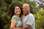 A happy mixed race couple relax outside in the back yard or garden - with copy space