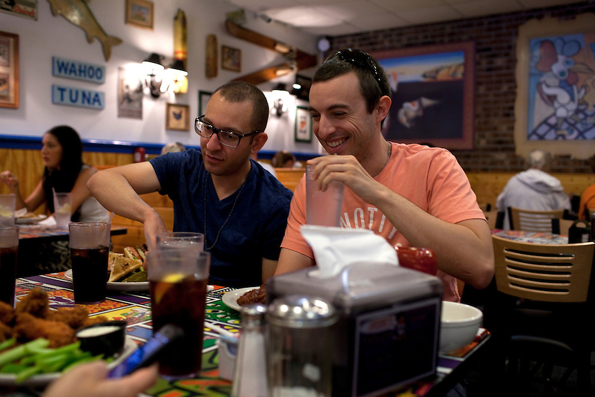 Long Beach Island, NJ - June 29, 2013 :  Christopher Burton and Brian DeAugustines from Toms River, NJ, have lunch with friends at The Chicken Or The Egg, open 24hrs, on Long Beach Island, NJ on June 29, 2013. People are returning to the beaches for the summer after recovery efforts post Superstorm Sandy.