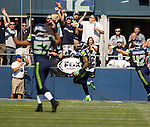 Fans celebrate as Seattle Seahawks strong safety Jeron Johnson returns a blocked Dallas punt for a 3-yard touchdown at CenturyLink Field in Seattle, Washington on September 16, 2012.  The Seahawks beat the Cowboys 27-7.  ©2012. Jim Bryant Photo.