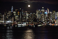 Skyline of New York City while the moon rise are seen from Weehawken in New Jersey March 27, 2013. Photo by Kena Betancur/ VIEWpress.