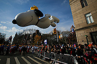 "the animated ""Peanuts"" characters Snoopy and Woodstock balloon floats through the parade route during the 89th Macy's Thanksgiving Annual Day Parade in the Manhattan borough of New York.  11/26/2015. Eduardo MunozAlvarez/VIEWpress"