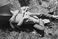 28 Jun 1970; Manhattan; New York City; New York State; USA.First Gay Parade was held in New York City. Two men in Central Park as the two lie on the ground and kiss for the kissing contest during New York's first Gay Pride celebration.