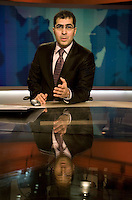 Newsreader Sami Zeidan broadcasts in the newsroom for news channel Al Jazeera English in Doha.