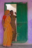 Women and teenage girls in their colorful saris in the streets of Jaisalmer, Rajasthan, India