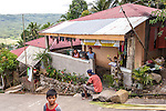 Sampaloc buri weaver Mercy Bala and her family in front of their home above Sampaloc, Quezon Provice, the Philippines.