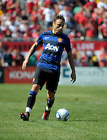 Manchester United forward Dimitar Berbatov (9) dribbles the ball.  Manchester United defeated the Chicago Fire 3-1 at Soldier Field in Chicago, IL on July 23, 2011.