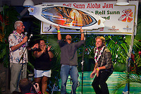 """HALEIWA, HI (Sunday Nov. 29, 2009) -- Fred Patacchia (HAW) paid $4000 for a one off Pat Rawson surfboard with a Clark Little (HAW) photograph under the glass.  The Rell Sunn Aloha Jam, a benefit for the The Rell Sunn Educational Fund and The Bronze Memorial Statue, was held tonight at Waimea Valley park on the North Shore. The entertainment included local musicians Henry Kapono (HAW), Paula Fuga (HAW), Jake Shimabukuro (HAW) and Cyril Pahinui (HAW). Former pro surfer Rob Machado (USA) also performed..There was a silent auction of surfboards and artwork donated by professional surfers and local artists and photographers. ..During her relatively short life, Rell Sunn's (HAW) generous spirit touched almost everyone she met. As the first female lifeguard in Hawaii, she saved many lives and was instrumental in developing women's professional surfing. As the founder of the Menehune Contest and a community leader, Aunty Rell dedicated herself to improving the lives of children, assisting senior citizens, and supporting breast cancer awareness. As an Ambassador of Hawaii, she spread aloha wherever she went. This memorial statue will be a timeless tribute to her warmth and grace...By donating to this project, you will be supporting the mission of the Rell Sunn Educational Fund, which is committed to educating the public, especially children/young adults, about health and environmental issues. Like Duke's statue, locals and visitors from all over the world will be drawn to her memorial, which will also be a tribute to the Hawaiian people and culture she loved so much. There will be a plaque sharing Rell's story so children and visitors will be inspired to learn why she was known as the"""" Queen of Makaha"""" and the """"Heart of the Sea"""" .Photo: Joliphotos.com"""
