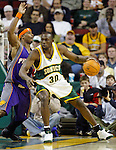 Seattle Supersonics' Reggie Evans makes a move to the basket past Phoenix Suns' Quentin Richardson in the first quarter at Key Arena in Seattle, Washington  on Sunday, 06 March 2005.  Jim Bryant Photo. &copy;2010. All Rights Reserved.