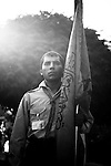 "8/30/2008 Ryak, Lebanon.An honor guard bearing the Mahdi Scout flag stands at attention at a Mahdi Scout Graduation ceremony at ""Scout City"" in Lebanon's Beka'a valley...The Imam al-Mahdi Scouts are one of Hezbollah's many social programs in Lebanon. Originally founded in 1985, the youth-centered scout program includes both boys and girls, and counts at least 40,000 members in it's ranks, divided into the classifications of Cub, Scout, and Ranger. Although the Mahdi Scouts are part of the Lebanese Scouting Federation, and thereby The World Organization of the Scout Movement, it is believed by some intelligence services that the Mahdi Scouts serve as a recruiting tool for Hezbollah's armed wing, filtering out potential fighters based on their discipline and religious devotion, as well as initiating the male Scouts and Rangers into basic military training. In contrast to these accusations, much of the Mahdi Scouts visible activities center around intense religious education, outdoor activities, arts and crafts, performances, as well as community based social assistance and service similar to those practiced by scout movements around the world..."