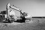 Excavator along shorefront .