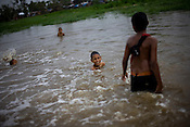 Young children play in the flooded parts of the capital city, Yangoon, Myanmar.