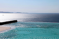 spectacular view of the Aegean Sea<br /> <br /> A 300 sq. mt. seaside home in Mykonos Greece which blends in seamlessly with the environment of the island.  It has a bioclimatic design which keeps the home cool instead of air conditioning and a spectacular view of the Aegean Sea.