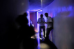 People loiter in a hallway in a club in Apgujeong, a ritzy area of Seoul, South Korea.