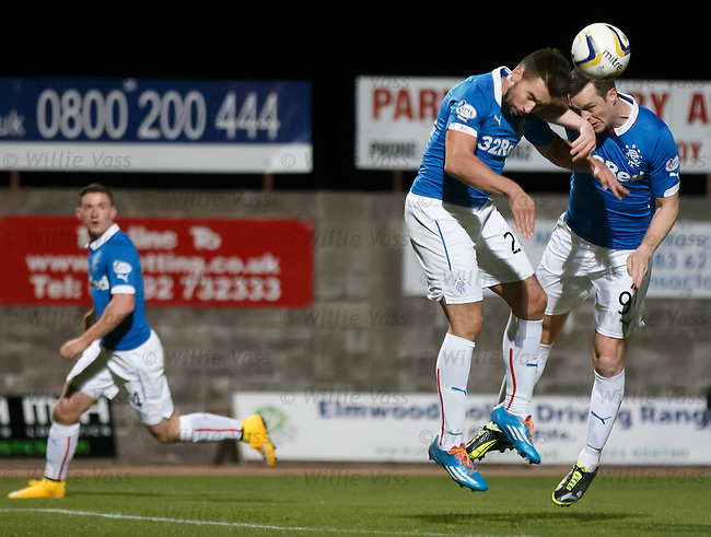 Fraser Aird looks on in awe as Darren McGregor and Jon Daly tackle each other as a corner kick is swung in