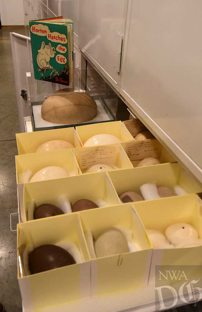 Northwest Arkansas Democrat Gazette/SPENCER TIREY <br /> An real elephant bird egg is seen  next to other eggs with a book by Dr. Zeuss  about an elegant laying an egg in the Univserity of Arkansas archeology departments archive in Fayetteville.