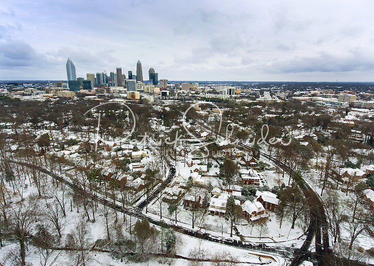 Charlotte Snow Photography - Photography of a snow covered Charlotte North Carolina skyline and the surrounding neighborhoods.<br /> <br /> Snow covered neighborhoods surround the uptown Charlotte North Carolina skyline. <br /> <br /> <br /> Charlotte Photographer - PatrickSchneiderPhoto.com