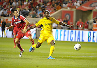 Chicago midfielder Marco Pappa (16) attempts to prevent Columbus midfielder Tony Tchani (6) from reaching a loose ball.  The Chicago Fire defeated the Columbus Crew 2-1 at Toyota Park in Bridgeview, IL on June 23, 2012.