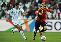 Fernando Torres (9) of Spain and Fareed Majeed (4) of Iraq. Spain defeated Iraq 1-0 during the FIFA Confederations Cup at Free State Stadium, in Mangaung/Bloemfontein South Africa on June 17, 2009.