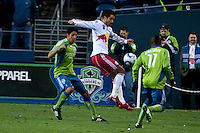 New York Red Bulls forward Juan Pablo Angel (c) works the ball against Leo Gonzalez (l) and Steve Zakuani (r) of the Seattle Sounders. The Sounders lost to the New York Red Bulls, 1-0, in an MLS match on Saturday, April 3, 2010 at Qwest Field in Seattle, WA.