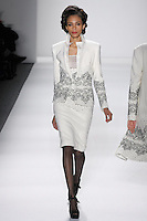 Model walks runway in an ivory wool boucle sculpted skirt suit bordered w/ivory+black reembroidered french lace sprinked w/ombre beads, from the Zang Toi Fall 2012 &quot;Glamour At Gstaad&quot; collection, during Mercedes-Benz Fashion Week New York Fall 2012 at Lincoln Center.