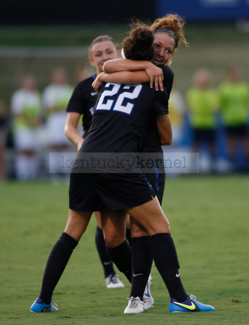 Freshman forward Cara Ledman (22) is hugged by junior forward Caitlin Landis after scoring a goal during the first half of the Women's Soccer game vs. UNC Greensboro at the UK Soccer Complex in Lexington, Ky., on Friday, August 31, 2012. Photo by Tessa Lighty   Staff