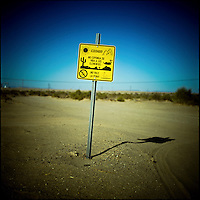 """A sign warns illiegal immigrants crossing the border from Mexico into California that the desert has many other dangers and that """"it isn't worth it."""""""