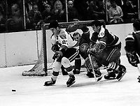 Seals vs Pittsburg Pengujins, 1970 play-off game.<br />Michel Briere, Seals Ted Hampson, goalie Chris Worthy.(photo by Ron Riesterer)