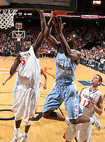 Jan. 8, 2011; Charlottesville, VA, USA;  North Carolina Tar Heels forward Harrison Barnes (40) is defended by Virginia Cavaliers center Assane Sene (5) during the game at the John Paul Jones Arena. North Carolina won 62-56. Mandatory Credit: Andrew Shurtleff