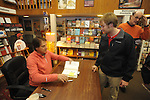"Retired St. Louis Cardinals manager Tony La Russa signs copies of his book ""One Last Strike"" for Ryan Whittington at Square Books in Oxford, Miss. on Thursday, November 29, 2012."