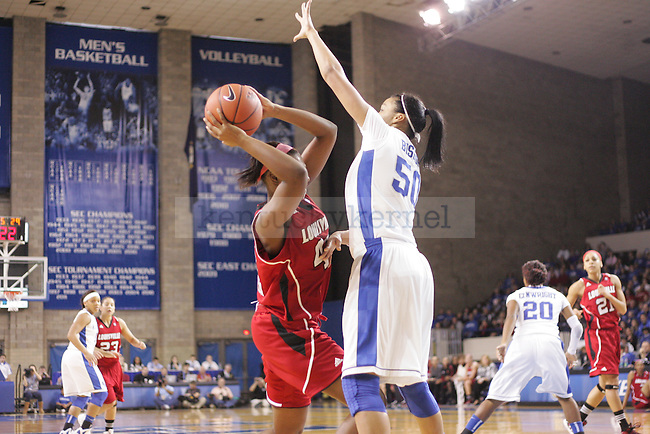 UK freshman center Azia Bishop attempts to block a shot by Cierra Warren of Louisville during the first half of the UK Women's basketball game against Louisville on 12/4/11 in Lexington, Ky. Photo by Quianna Lige | Staff