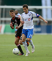 Perry Kitchen (23) of D.C. United fights for the ball with Sinisa Ubiparipovic (28) of the Montreal Impact during the game at RFK Stadium in Washington DC.   D.C. United defeated the Montreal Impact, 3-0.